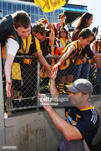 Hawks head coach Alastair Clarkson is greeted by fans when walking off during a Hawthorn Hawks AFL training session at Waverley Park on October 1...