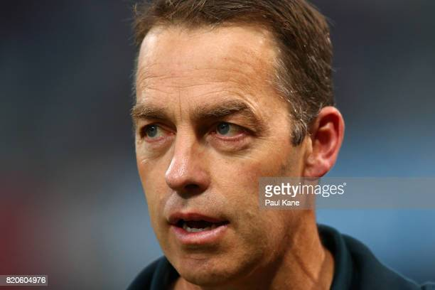 Hawks head coach Alastair Clarkson looks on while players warm up before the round 18 AFL match between the Fremantle Dockers and the Hawthorn Hawks...