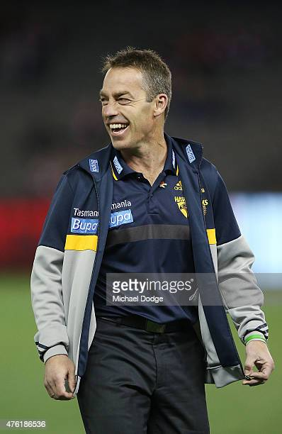 Hawks head coach Alastair Clarkson reacts after meeting former Australian Test cricketer and Saints fan Shane Warne who was playing a Saints...
