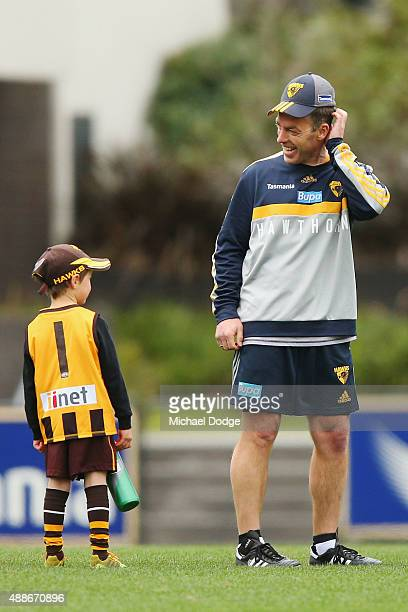 Hawks head coach Alastair Clarkson reacts to a young fan during a Hawthorn Hawks AFL training session at Waverley Park on September 17 2015 in...
