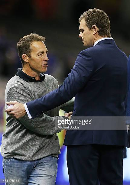 Hawks head coach Alastair Clarkson shakes hands with Fox Footy commentator Cameron Mooney after being interviewed by television commentators during...