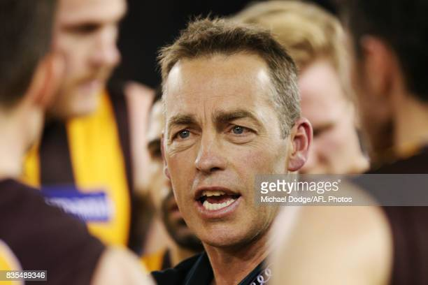 Hawks head coach Alastair Clarkson speaks to his players during the round 22 AFL match between the Carlton Blues and the Hawthorn Hawks at Etihad...