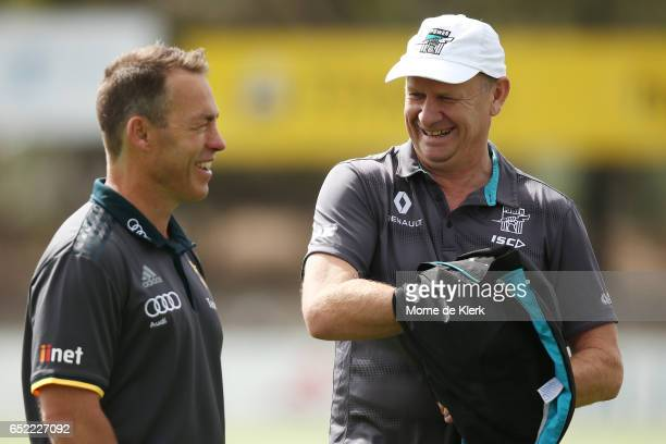 Hawks head coach Alastair Clarkson speaks to Ken Hinkley of the Power before the JLT Community Series match between the Port Adelaide Power and the...