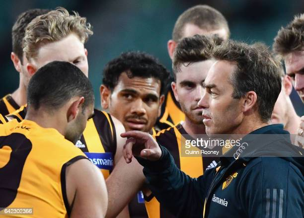 Hawks head coach Alastair Clarkson talks to his players during the 2017 JLT Community Series match between the Hawthorn Hawks and the Geelong Cats at...