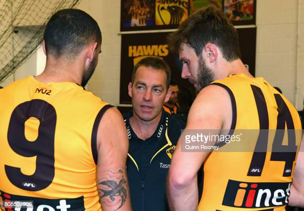 Hawks head coach Alastair Clarkson talks to Shaun Burgoyne and Grant Birchall during the round 15 AFL match between the Hawthorn Hawks and the...