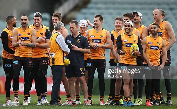Hawks head coach Alastair Clarkson talks with a supporter in front of the team during a Hawthorn Hawks AFL training session at Domain Stadium on...