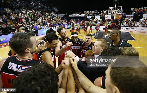 Hawks players and coaches celebrate victory in the round 17 NBL match between the Illawarra Hawks and the Adelaide 36ers at WIN Entertainment Centre...