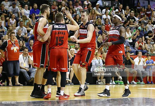 Hawks players celebrate a basket during the round 17 NBL match between the Illawarra Hawks and the Adelaide 36ers at WIN Entertainment Centre on...