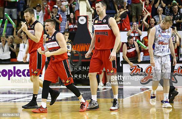 Hawks players celebrate victory during the round 17 NBL match between the Illawarra Hawks and the Adelaide 36ers at WIN Entertainment Centre on...