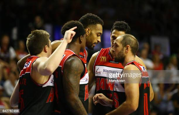 Hawks players form a huddle during the second NBL Semi Final match between Illawarra Hawks and the Adelaide 36ers at WIN Entertainment Centre on...