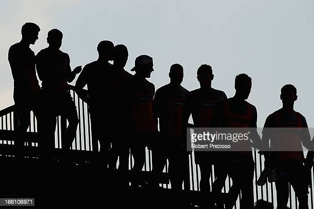 Hawks players walk down stairs during a Hawthorn Hawks AFL recovery session at Waverley Park on April 9 2013 in Melbourne Australia