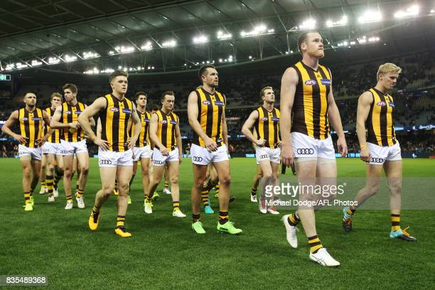 Hawks players walk off after defeat during the round 22 AFL match between the Carlton Blues and the Hawthorn Hawks at Etihad Stadium on August 19...