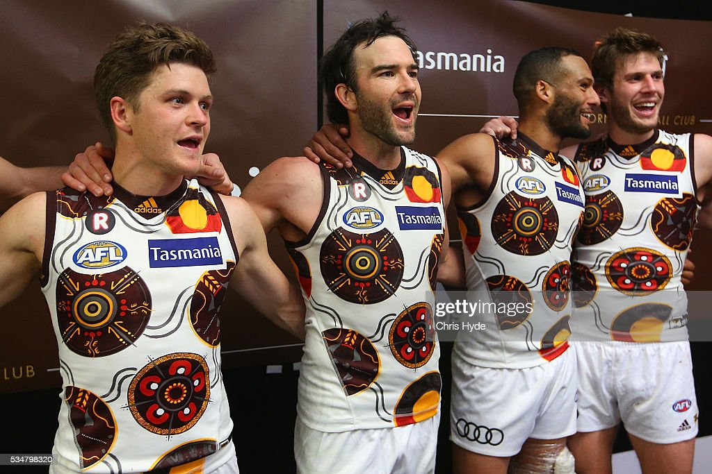 Hawks sing the team song after winning the round 10 AFL match between the Brisbane Lions and the Hawthorn Hawks at The Gabba on May 28, 2016 in Brisbane, Australia.