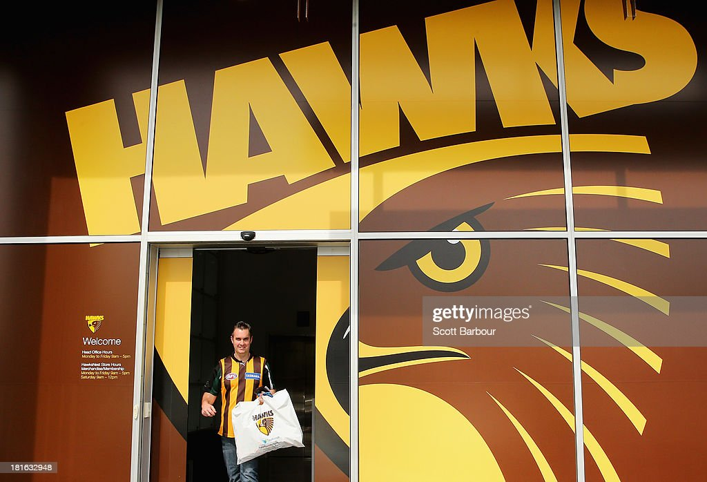A Hawks supporter leaves the HawksNest merchandise store after purchasing Hawks gear on September 23, 2013 in Melbourne, Australia. The Hawthorn Hawks play the Fremantle Dockers this Saturday in this year's 2013 AFL Grand Final.