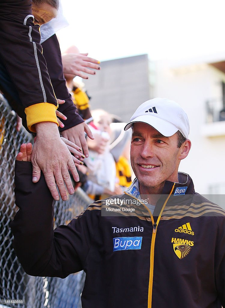 Hawks supporters show their support for coach Alastair Clarkson during a Hawthorn Hawks AFL training session at Waverley Park on September 26, 2013 in Melbourne, Australia.