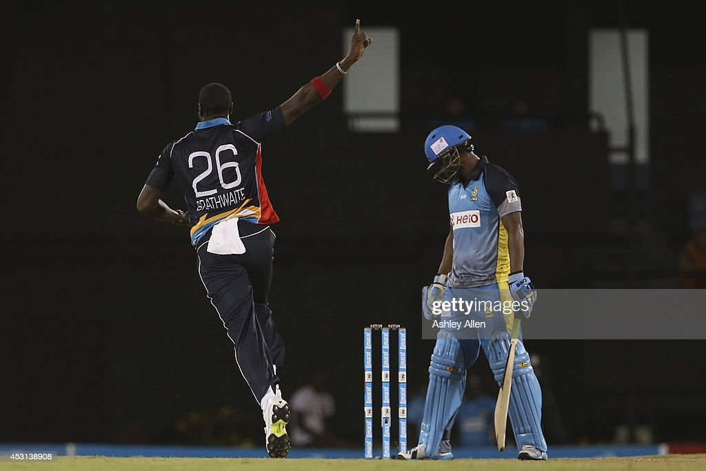 Hawksbills bowler <a gi-track='captionPersonalityLinkClicked' href=/galleries/search?phrase=Carlos+Brathwaite&family=editorial&specificpeople=8538686 ng-click='$event.stopPropagation()'>Carlos Brathwaite</a> (L) picks up the wicket of Johnson Charles (R) of the St Lucia Zouks during a match between St. Lucia Zouks and Antigua Hawksbills as part of week 4 of the Limacol Caribbean Premier League 2014 at Beausejour Stadium on August 03, 2014 in Castries, St. Lucia.