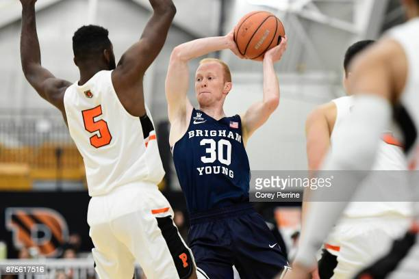 Haws of the Brigham Young Cougars looks to pass against Amir Bell of the Princeton Tigers during the first half at L Stockwell Jadwin Gymnasium on...