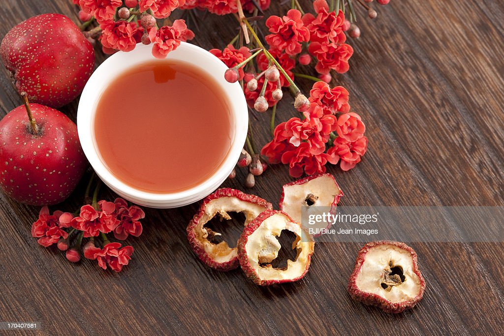 Hawthorn and hawthorn juice with wintersweet flower : Stock Photo