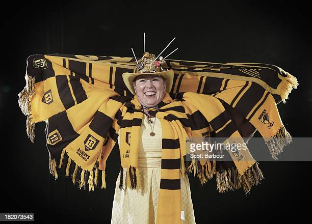 A Hawthorn Hawks fan poses ahead of the 2013 AFL Grand Final match between the Hawthorn Hawks and the Fremantle Dockers at the Melbourne Cricket...