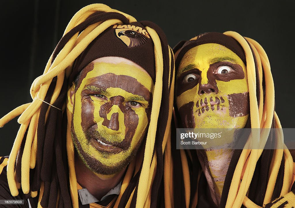Hawthorn Hawks fans pose ahead of the 2013 AFL Grand Final match between the Hawthorn Hawks and the Fremantle Dockers at the Melbourne Cricket Ground on September 28, 2013 in Melbourne, Australia.