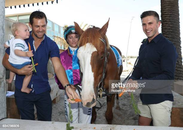 Hawthorn Hawks footballer Luke Hodge and Carlton Blues footballer Marc Murphy pose with Apache Cat during the Festival of Racing Media Launch the the...