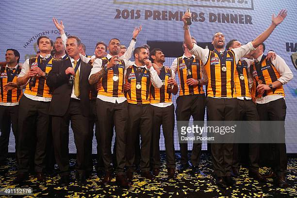 Hawthorn Hawks join Daryl Braithwaite on stage for a performance of Horses during the Hawthorn Hawks AFL Grand Final dinner at Crown Palladium on...