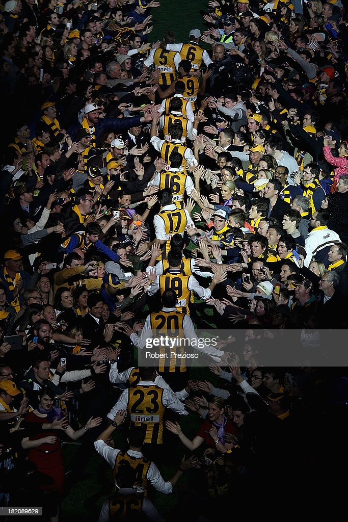 Hawthorn players arrive for the post match AFL Grand Final party at Melbourne Cricket Ground on September 28, 2013 in Melbourne, Australia.