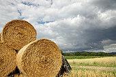hay bales on stubble field