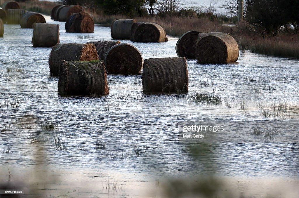 Hay bales stand in flood water in fields surrounding the Glastonbury Tor on the Somerset Levels, on November 25, 2012 near Glastonbury, England. Another band of heavy rain and wind continued to bring disruption to many parts of the country today particularly in the south west which was already suffering from flooding earlier in the week.