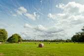 Hay bales with cloudy sky