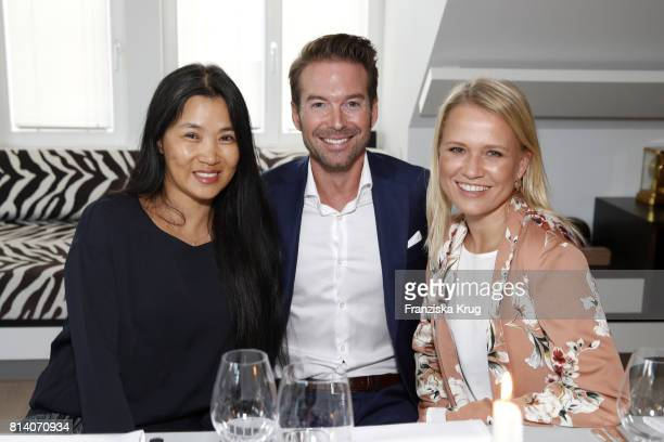 Hayah Juergens Nova Meierhenrich and Sebastian Hoeffner during the Clos19 dinner on July 13 2017 in Munich Germany