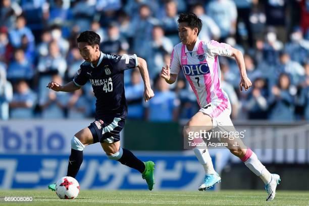 Hayao Kawabe of Jubilo Iwata and Daichi Kamada of Sagan Tosu compete for the ball during the JLeague J1 match between Jubilo Iwata and Sagan Tosu at...