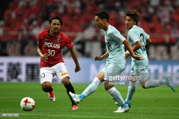 Hayao Kawabe of Jubilo Iwata and Shinzo Koroki of Urawa Red Diamonds compete for the ball during the JLeague J1 match between Urawa Red Diamonds and...