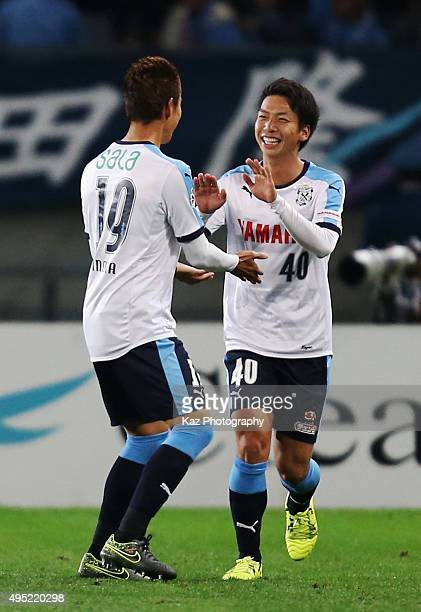 Hayao Kawabe of Jubilo Iwata celebrates scoring his team's first goal with his team mate Masahiko Inoha during the JLeague second division match...