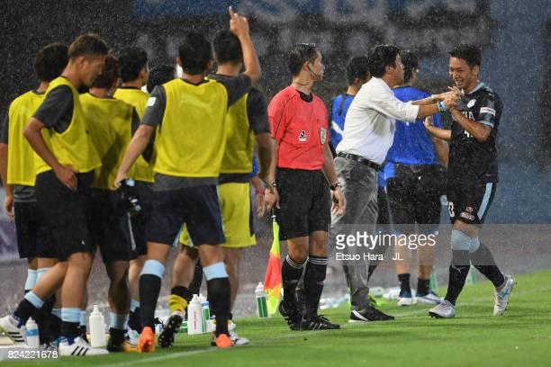 Hayao Kawabe of Jubilo Iwata celebrates scoring the opening goal with head coach Hiroshi Nanami during the JLeague J1 match between Kawasaki Frontale...