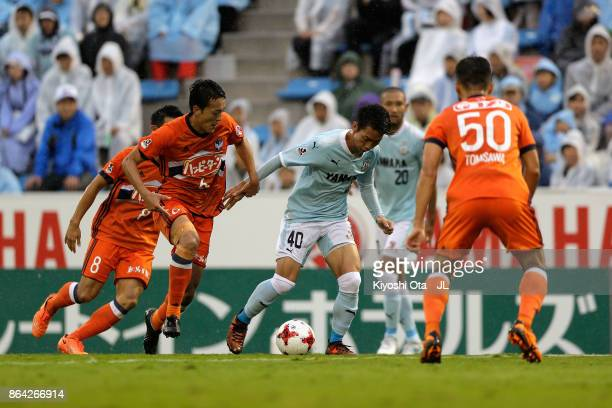Hayao Kawabe of Jubilo Iwata competes for the ball against Albirex Niigata defense during the JLeague J1 match between Jubilo Iwata and Albirex...