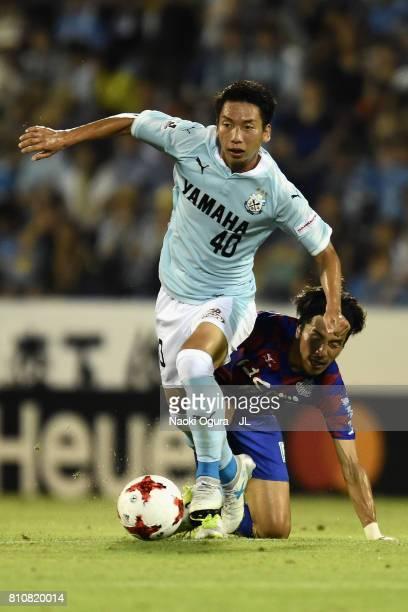 Hayao Kawabe of Jubilo Iwata goes past Shohei Ogura of Ventforet Kofu during the JLeague J1 match between Jubilo Iwata and Ventforet Kofu at Yamaha...