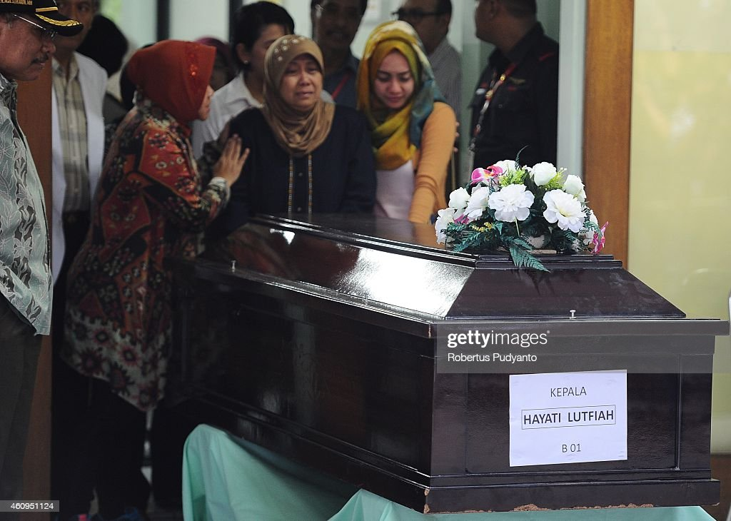 Hayati Lutfiah Hamid's the mother of the first identified victim of the AirAsia flight QZ8501 cries during a handover ceremony from AirAsia to her...
