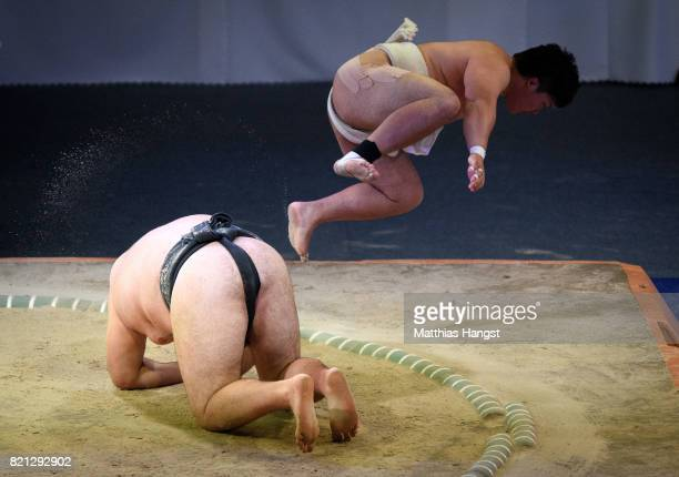 Hayato Miwa of Japan jumps over Oleksandr Veresiuk of Ukraine during the Sumo Open Weight Men's Competition of The World Games at Orbita Hall on July...