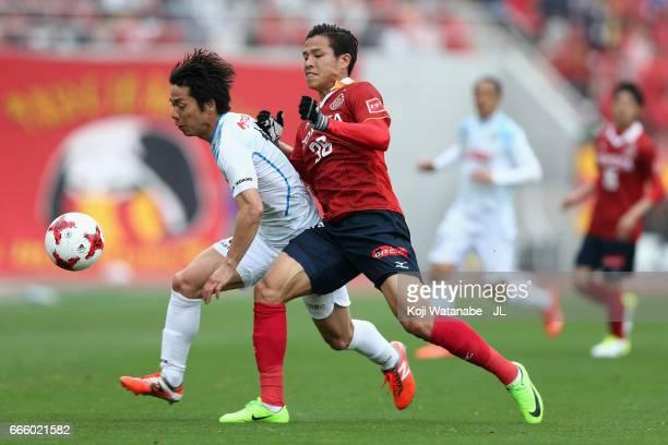 Hayato Nakama of Kamatamare Sanuki and Ryo Nagai of Nagoya Grampus compete for the ball during the JLeague J2 match between Nagoya Grampus and...