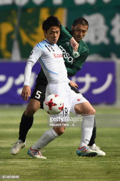 Hayato Nakama of Kamatamare Sanuki controls the ball under pressure of Yudai Iwama of Matsumoto Yamaga during the JLeague J2 match between Matsumoto...