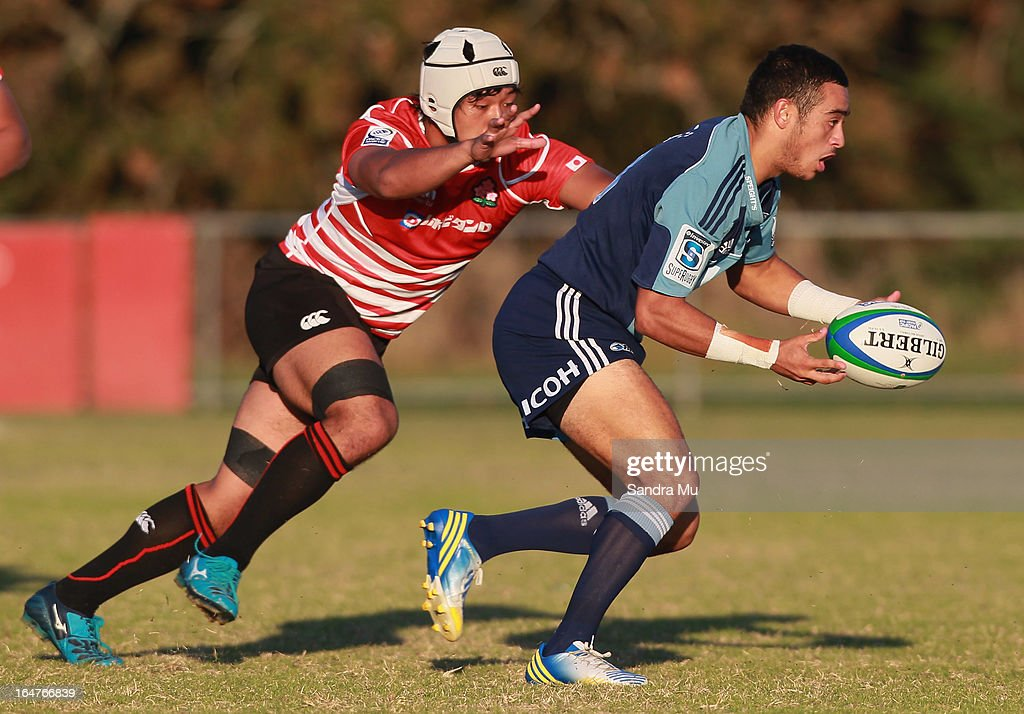 Hayato Nishiuchi of Japan (L) looks to tackle Bryn Hall of the Blues during the Pacific Rugby Cup match between the Blues Development and Junior Japan at Bell Park on March 28, 2013 in Auckland, New Zealand.