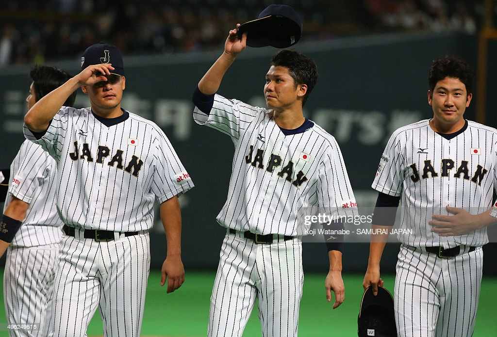 Hayato Sakamoto (C) #6 and players Japan celebrate after his team's 5-0 win in the WBSC Premier 12 match between Japan and South Korea at the Sapporo Dome on November 8, 2015 in Sapporo, Japan.