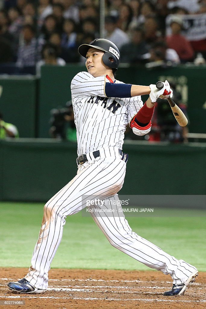 Hayato Sakamoto #6 hits a three-run double in the fifth inning during the international friendly match between Japan and Netherlands at the Tokyo Dome on November 12, 2016 in Tokyo, Japan.