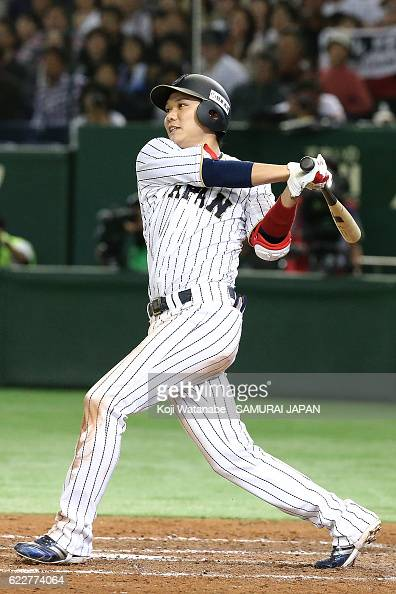 Hayato Sakamoto hits a threerun double in the fifth inning during the international friendly match between Japan and Netherlands at the Tokyo Dome on...