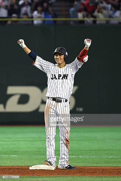 Hayato Sakamoto of Japan celerbrates after hitting a threerun double in the fifth inning during the international friendly match between Japan and...