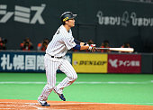 Hayato Sakamoto of Japan hits a sacrifice fly in the bottom of the second inning during the WBSC Premier 12 match between Japan and South Korea at...