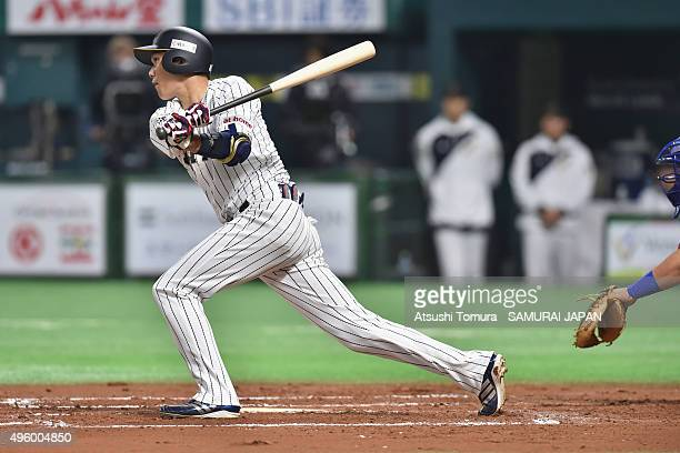 Hayato Sakamoto of Japan hits a single in the bottom half of the seventh inning during the sendoff friendly match for WBSC Premier 12 between Japan...