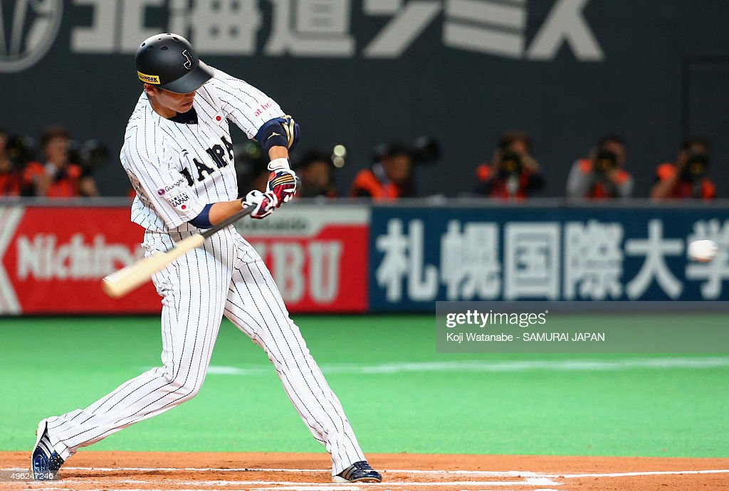 Hayato Sakamoto #6 of Japan hits a solo homer in the bottom of the sixth inning during the WBSC Premier 12 match between Japan and South Korea at the Sapporo Dome on November 8, 2015 in Sapporo, Japan.