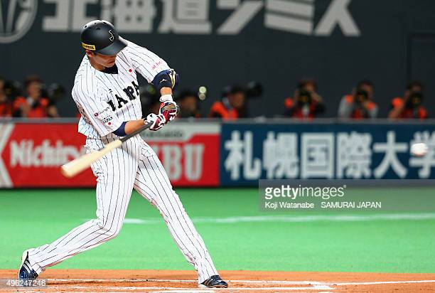 Hayato Sakamoto of Japan hits a solo homer in the bottom of the sixth inning during the WBSC Premier 12 match between Japan and South Korea at the...